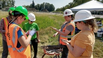 Researchers in field doing geotechnical earthquake engineering project