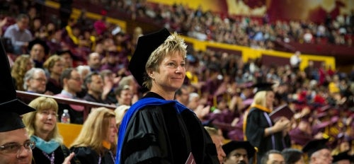 Mary Niemczyk stands at commencement