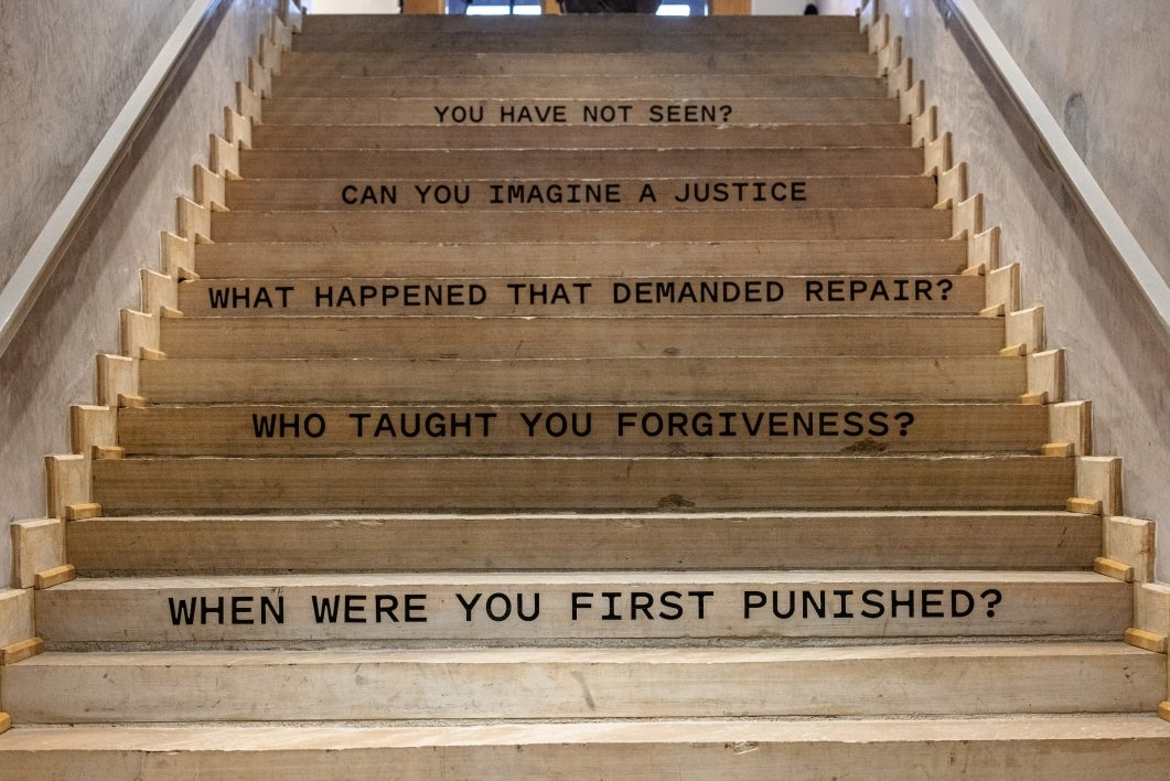 Phrases about incarceration painted on stairs