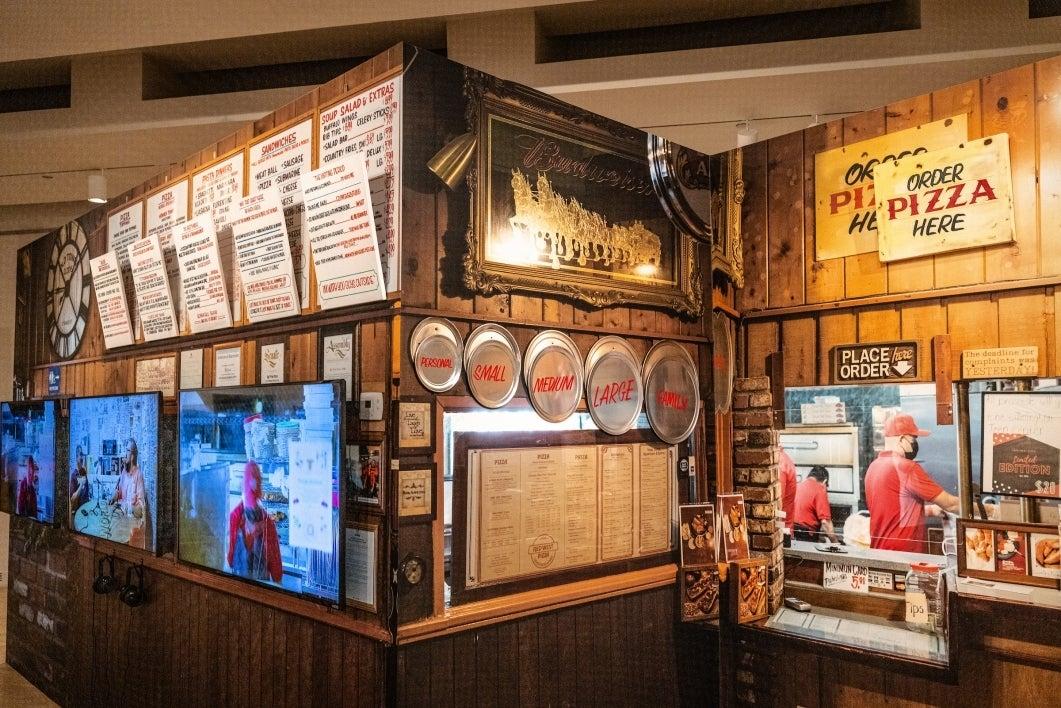 art exhibit that mimics a pizza parlor