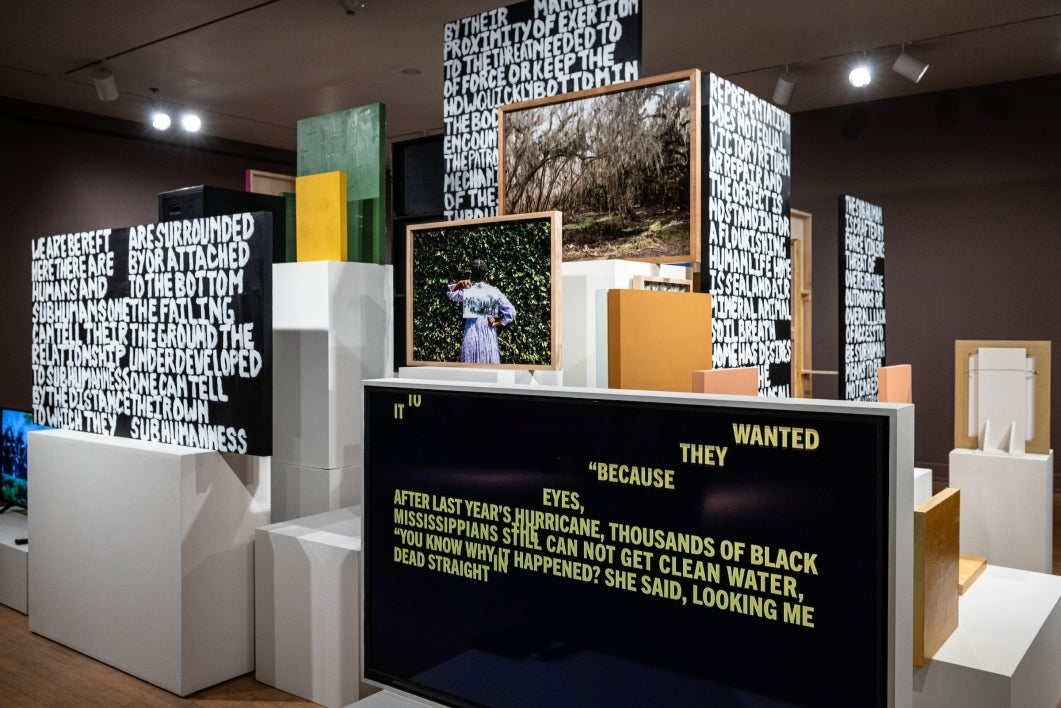 Gallery exhibit with words painted on blocks