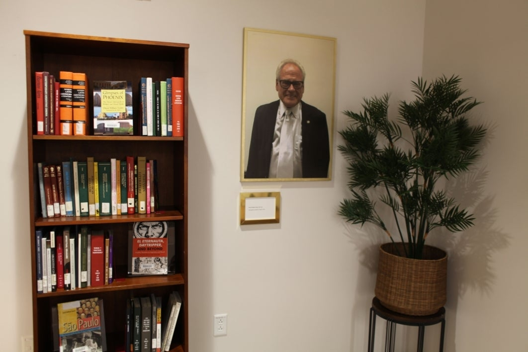 memorial exhibit with photo and bookcase