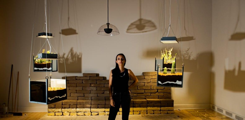 woman standing in mixed-media exhibit
