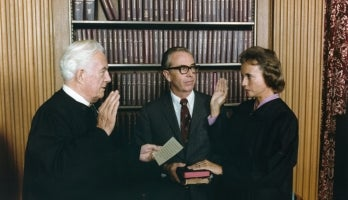 Sandra Day O Connor is sworn in by Chief Justice Warren Burger as her husband watches on Sept 25 1981