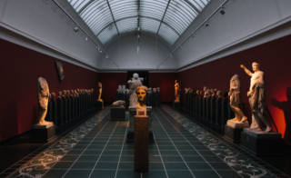 Photo of a room filled with statues and busts