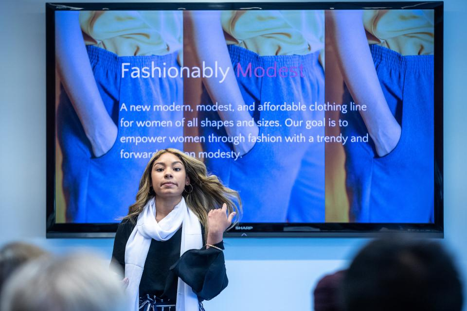 Sophia Collier describes Sotra Fashion to the judges