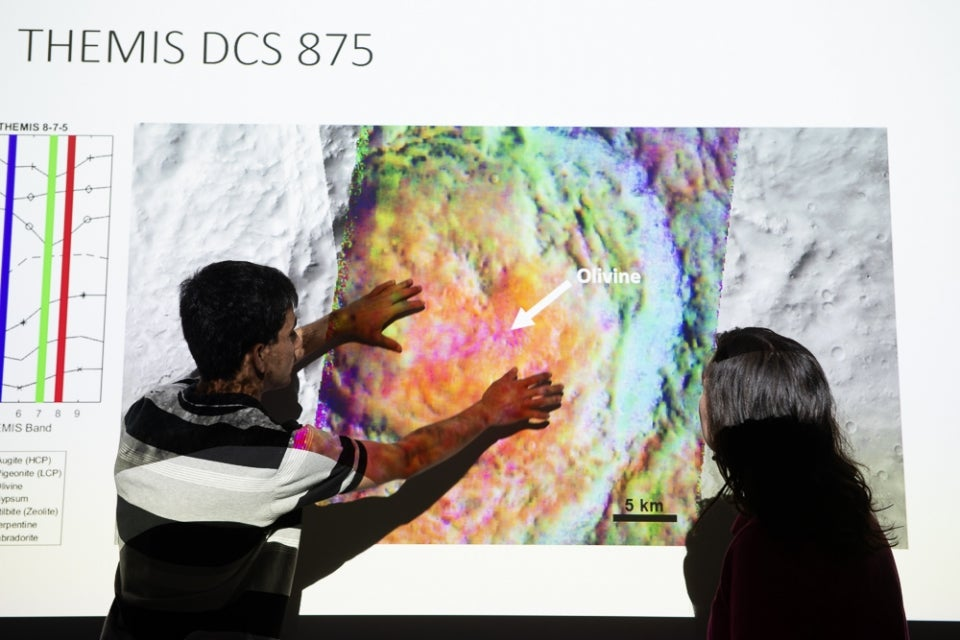 ASU student Aditya Khuller points to a map of Mars