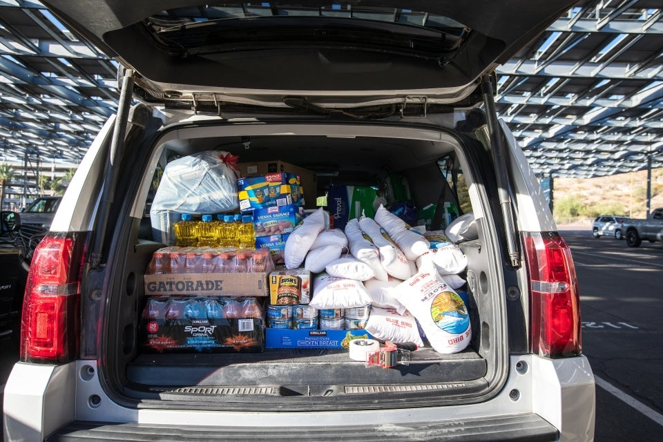 back of an SUV loaded with food donations