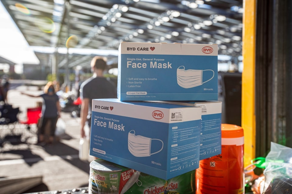 face masks sit on a stack of boxes