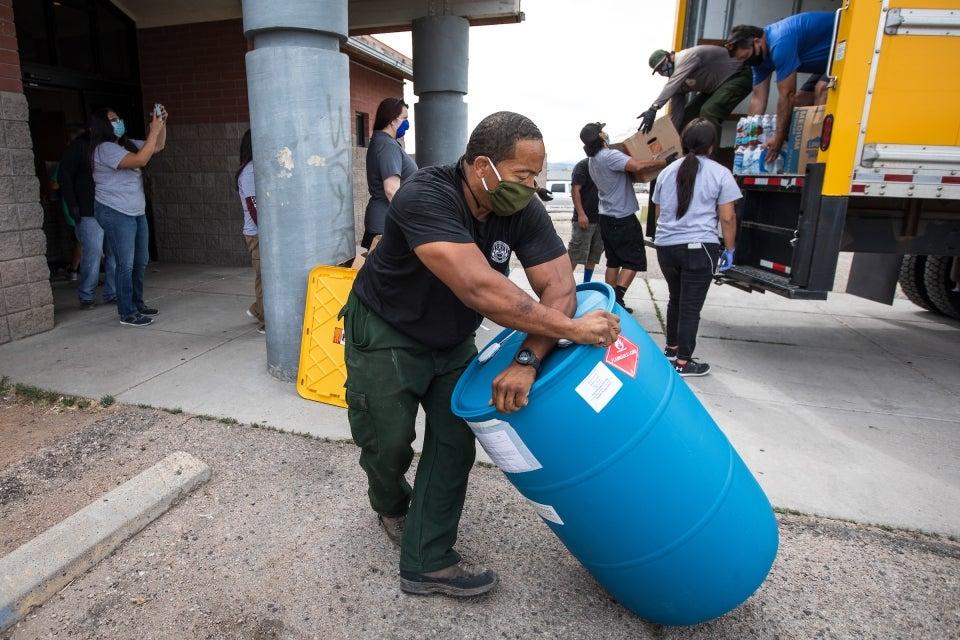 Volunteers unloading supplies donations