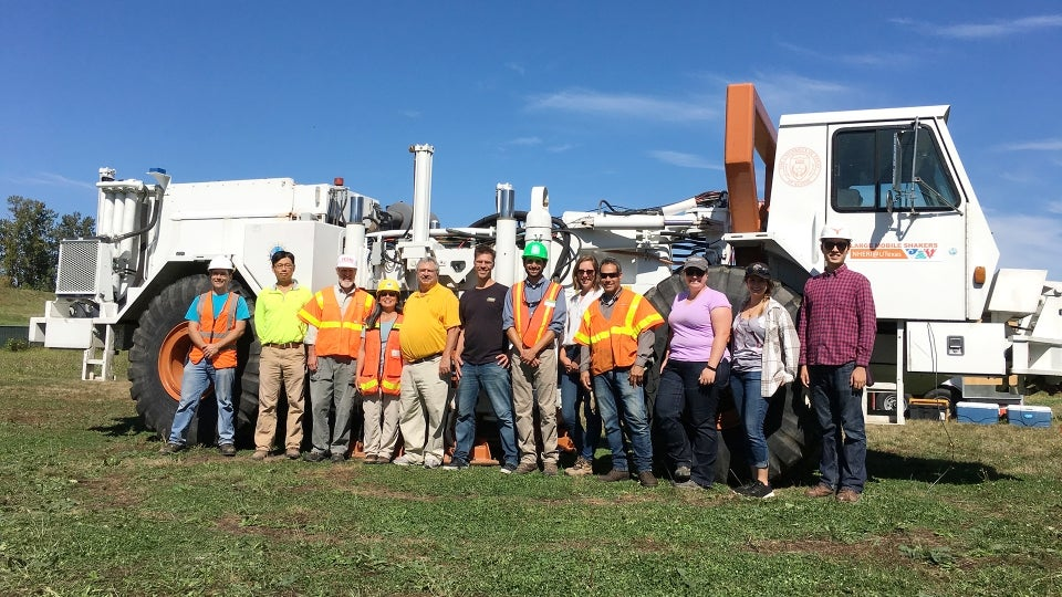 Geotechnical engineering team with T-Rex ground shaker at test site in Oregon