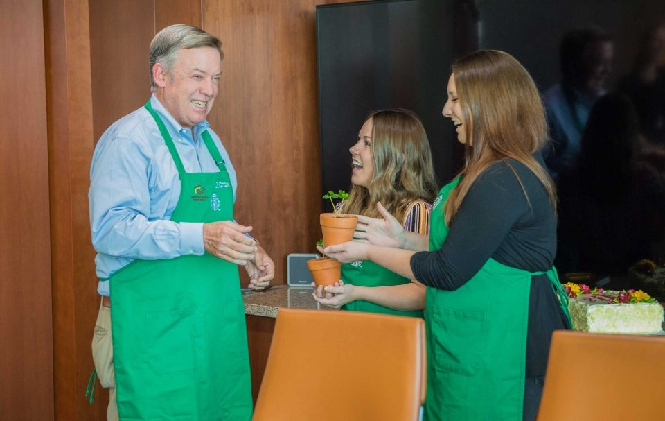 ASU President Michael Crow accepts coffee trees from Starbucks partners