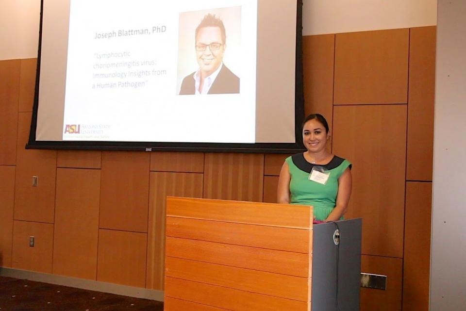 woman standing behind podium