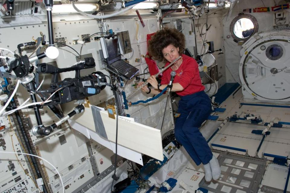 Astronaut Cady Coleman plays a flute in space