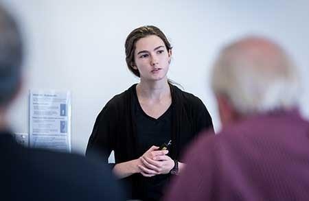 A woman presents a business idea to investors