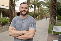 man standing on ASU's Palm Walk