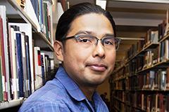 man's portrait in library