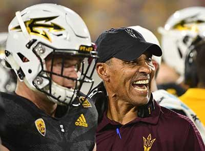 ASU football Coach Herm Edwards on the sideline during a game