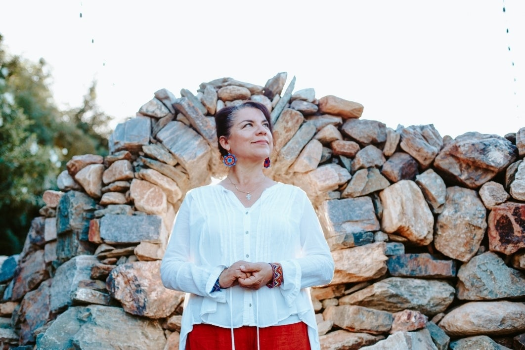 woman standing in front of rock formation