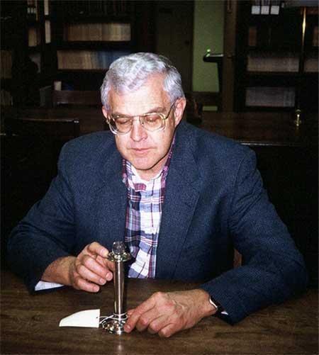ASU Charles Merbs examines grapeshot which killed Pulaski