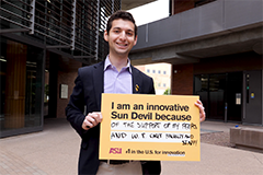 """student holding sign that says """"I am an innovative Sun Devil because of the the support of my peers and W. P. Carey faculty and staff!"""""""