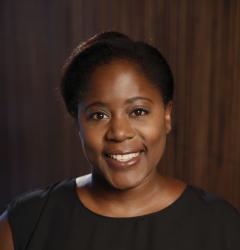 Woman in black shirt smiling