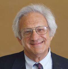 Man in glasses and tie smiling