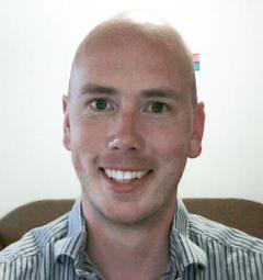 Man in stripped shirt smiling