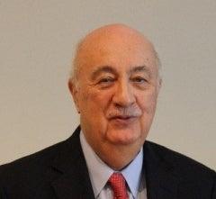 Man in red tie and dark jacket