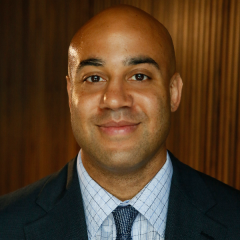 Bald man in tie and suit