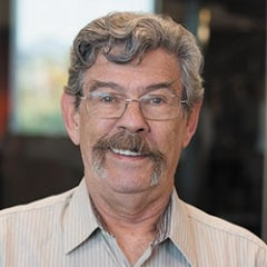 Man in glasses with mustache
